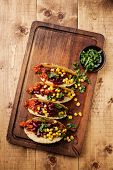 Tacos With Ground Beef, Corn And Red Beans On Wooden Table