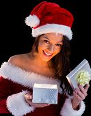 Pretty brunette in santa outfit opening gift on black background