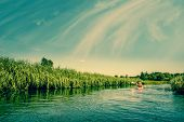 stock photo of canoe boat man  - Two Men Canoeing Down The River At Summertime - JPG