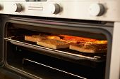 Cheese On Toast Being Grilled In Oven