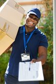 african delivery man carrying parcel and presenting receiving form