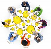 Group of People with Light Bulb Symbol in Photo and Illustration