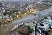 Aerial view of battleship docked in the river Thames