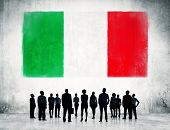 Italian flag and a group of business people.