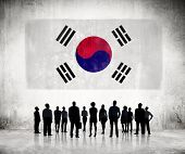 Silhouettes of Business People Looking at the South Korean Flag