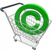 A green 3d copyright symbol in a shopping cart illustrating the purchase or buying legally protected
