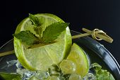 Fresh Lime Mojito over dark background