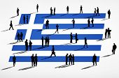 Greek flag and a group of business people.