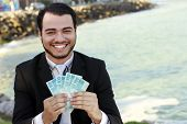 stock photo of brazilian money  - business man with money brazilian on hands - JPG
