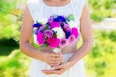 Bridesmaid Holds A Wedding Bouquet Of Roses In Purple Tones. Floristic Composition In Vintage Style.