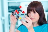girl student holding a model of chemical molecules