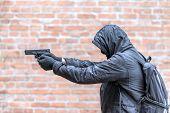man in mask with handgun