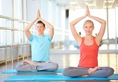 Portrait of healthy girl and guy going for yoga in gym