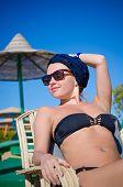 Young woman enjoying sun at the beach