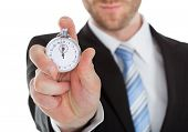 Midsection Of Businessman Showing Stopwatch