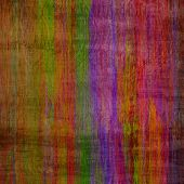 art abstract colorful silk textured blurred background in green, red, gold and violet colors