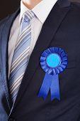 Closeup Of Businessman Wearing Blue Ribbon
