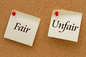 picture of karma  - Fair versus Unfair Two yellow sticky notes on a cork board with the words Fair and Unfair - JPG