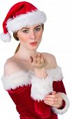 Pretty girl in santa costume holding hand out on white background