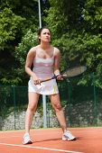 Pretty tennis player ready to play on a sunny day