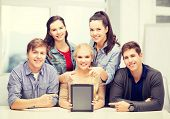 education, technology, advertisement and internet concept - group of smiling students with blank bla