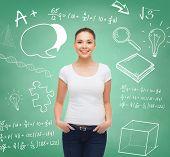 advertising, education, school and people concept - smiling young woman in blank white t-shirt over