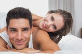 Close up portrait of romantic young couple in bed at home