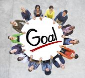Group of People Holding Hands Around the Word Goal