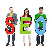 DIverse People Holding Text SEO