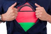 Young Sport Fan Opening His Shirt And Showing The Flag His Country Malawi, Malawian Flag