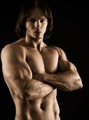 picture of arm muscle  - Photo of an attractive young muscular man with no shirt posing with his arms crossed - JPG