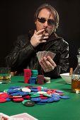 Smoking Poker Player Wearing Sunglasses