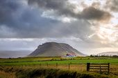 pic of iceland farm  - Rainstorm over a farm in Iceland - JPG