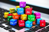 image of cube  - Macro view of group of color cubes with domain names on laptop or notebook keyboard with selective focus effect - JPG