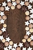 Gingerbread biscuit background border over old oak wood.