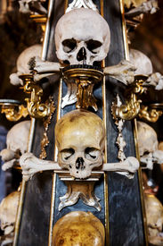 picture of skull crossbones flag  - Human skull in the basement vault lined one over the other. Symbol pirate flag ** Note: Soft Focus at 100%, best at smaller sizes - JPG