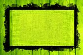 image of lime  - lime canvas textured on lime wood background with black frame design - JPG