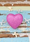 Pink Hearts And Ribbons On Grungy Light Blue Wooden Background