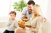 Family Enjoying Pastries