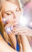 Portrait Of Attractive Blond Girl With Golden Minx Manicure