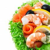 Seafoods - Shrimp And Salmon. Garnished With Fresh Raw Salad Leaf.