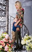 foto of spiral staircase  - son hugging her mother on the spiral staircase  - JPG