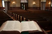Bible facing empty church