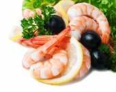 Sea Foods - Shrimps. Garnished With Fresh Raw Salad Leaf Olive And Lemon, Isolated On The White Back
