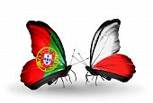 Two Butterflies With Flags On Wings As Symbol Of Relations Portugal And  Poland