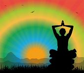 man silhouette meditating