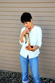 Female trumpet player.