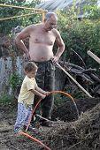 Grandson Watering Seedling