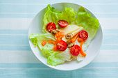 image of top-less  - A healthy fresh and green salad in white bowl  - JPG