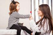 Little Girl Getting A Lollipop